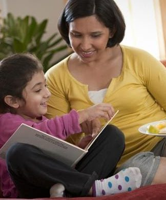 Picture of daughter reading a book to her mother